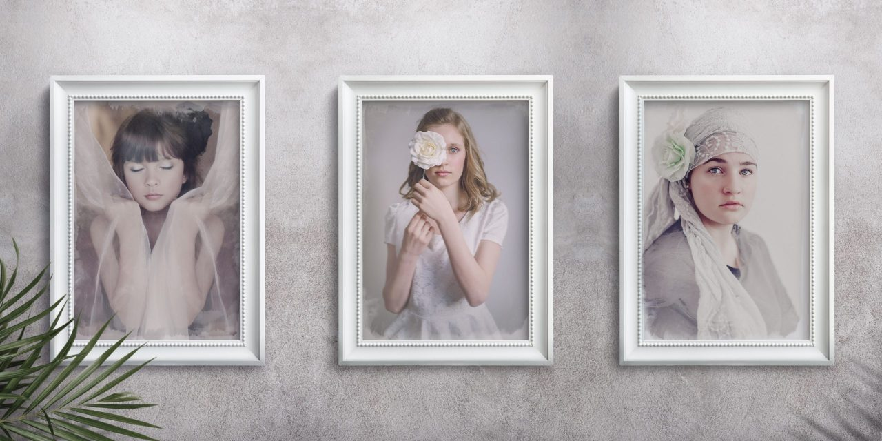 fine art portraits on textured wall with white frames