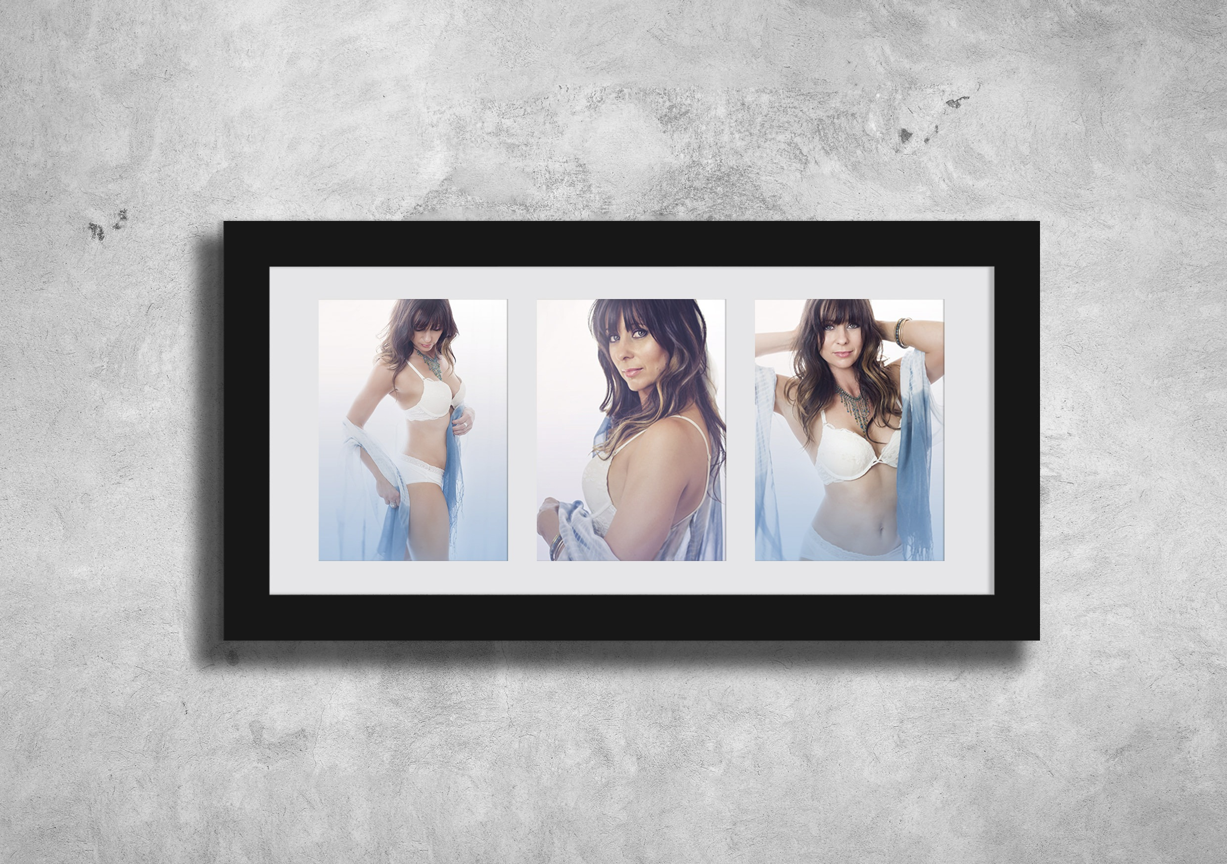 boudoir portraits of lady framed on wall